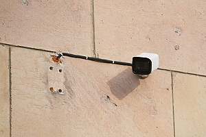 a CCTV installed on the side of a commercial office building
