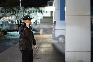 a security guard patrolling a commercial office building at night